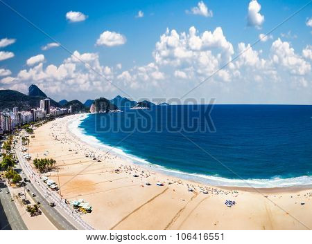 Panoramic view on Copacabana beach with city skyline of Rio de Janeiro, Brazil.