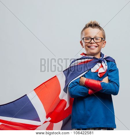 Smiling Superhero Boy With British Flag Cape