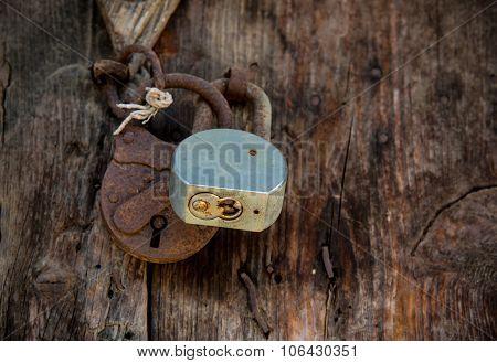 Metal Rusty Padlock On A Closed Old Wooden Door