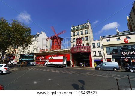 PARIS, FRANCE - AUGUST 10, 2015: Moulin Rouge building. Moulin Rouge is a cabaret in Paris, France. Moulin Rouge is best known as the spiritual birthplace of the modern form of the can-can dance.
