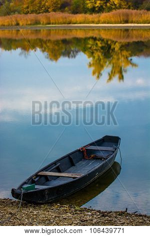 Boat On Calm Sea In Autumn