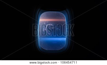 Beautiful cosmos in space ship window porthole. Elements of this image furnished by NASA. poster