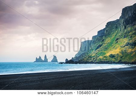 Famous Reynisdrangar Rock Formations And The Mount Reynisfjall.