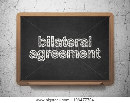 Insurance concept: Bilateral Agreement on chalkboard background