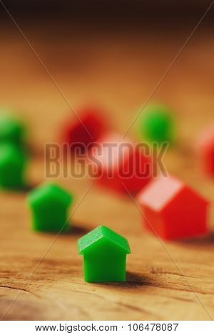 Plastic Houses On Wooden Table