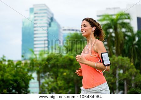Happy Fitness Woman Running At City Park