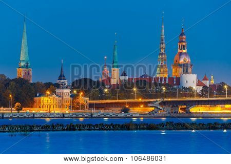Old Town of Riga and River Daugava at night, Riga Cathedral, Saint Peter church, Cathedral Basilica of Saint James and Riga castle in the background, Latvia poster