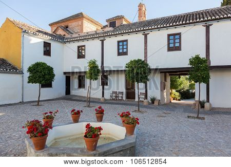 Warm Courtyard With Well Or Fountain In Spain