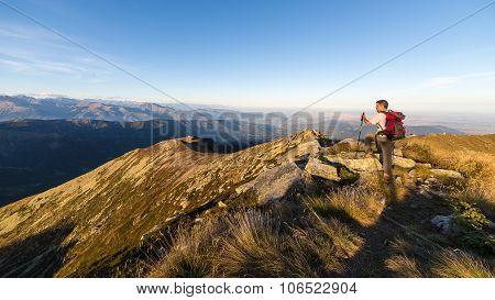 Hiking On The Mountain Ridge On The Alps