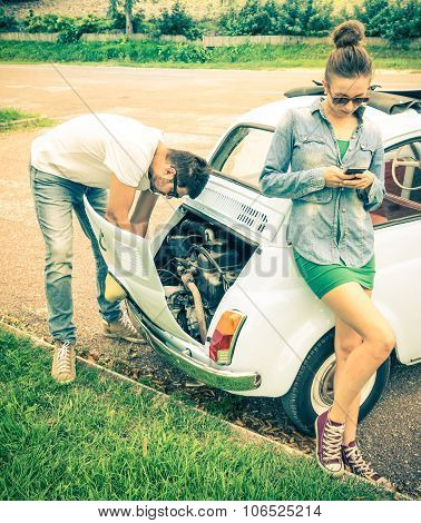 Couple In A Moment Of Troubles During A Vintage Classic Car Trip - Concept Of Modern Relationship