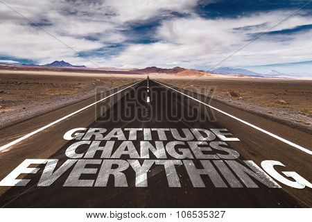 Gratitude Changes Everything written on desert road