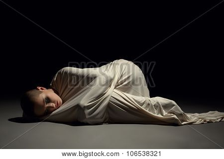 Studio photo of mentally ill woman in straitjacket, on grey background poster