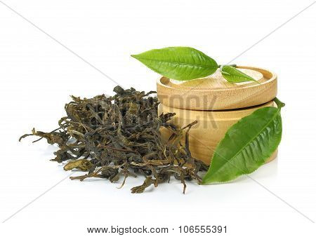 Dry Black Tea With Green Leaves On White Background