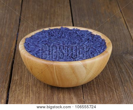 Jasmine Rice Coated With Butterfly Pea Herb In Bowl Wooden On Wood Background
