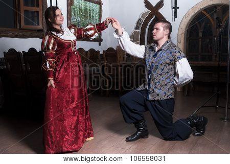 Attractive couple in retro dresses dance