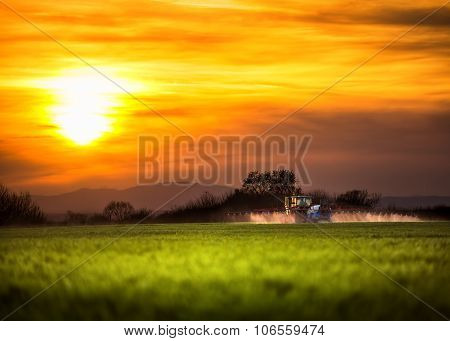 Farming Tractor Plowing And Spraying