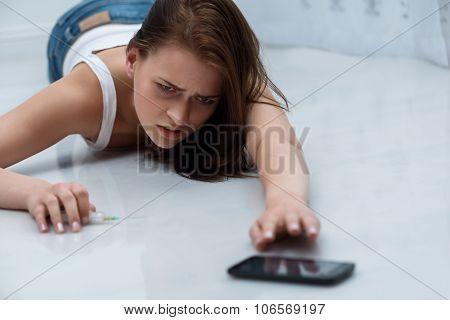 Desperate girl lying on the floor