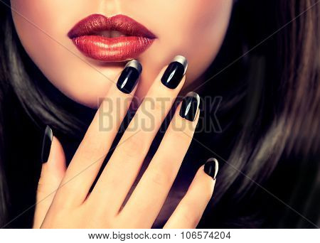 Beautiful model brunette shows black and silver French manicure on nails. Luxury fashion style, mani
