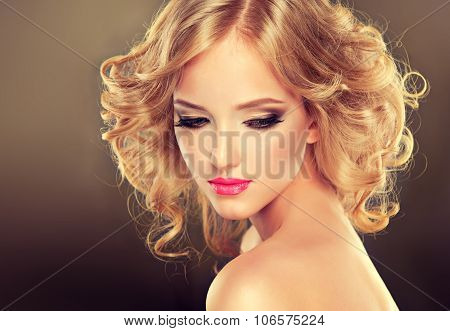 Pretty blonde girl with hairstyle  curled hair .Hairstyle medium length