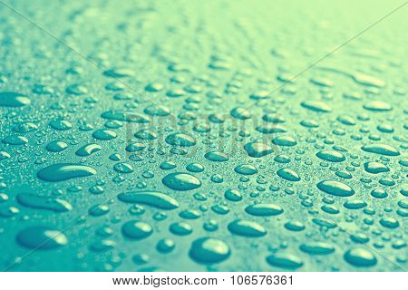 Water Drops On Blue Surface With Small Depth Of Field