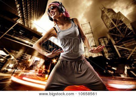 Beautiful dancing girl on a street
