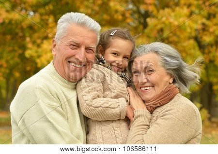 Grandparents with her granddaughter
