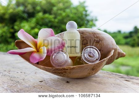 Mini set of bubble bath and shower gel decorated with beautiful flower on relaxing nature background poster