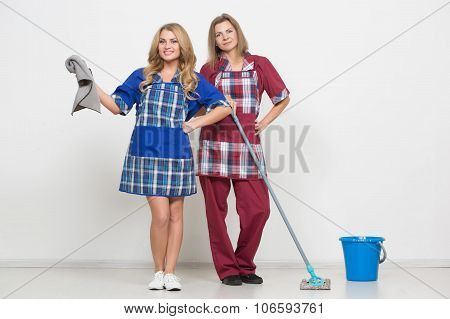 two different cleaners compete to clean. poor staff poster