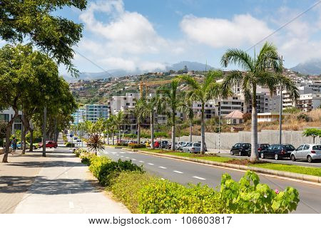 Street in tropical city on sunny day in mountains