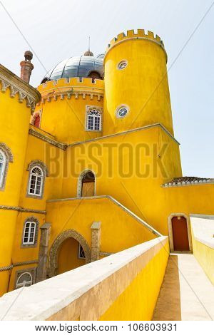Beautiful yellow castle with towers against the sky