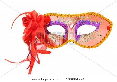 Festive carnival mask with a bow and ribbons on a white background