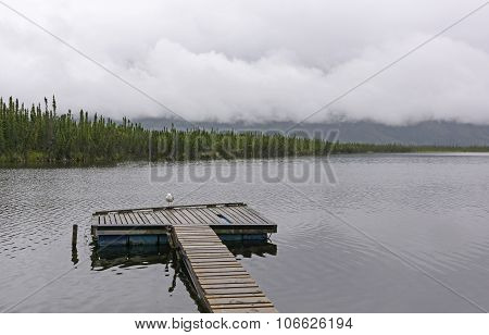 Lonely Dock on a Cloudy Day on Axehead Lake in the Yukon poster