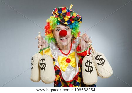 Clown with money bag in funny concept