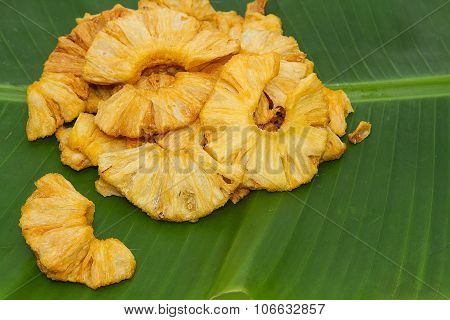 Dried dehydrated pineapple , on banana leaf background poster