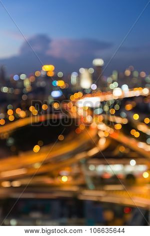 Aerial view city downtown road intersection during twilight, blurred bokeh light background