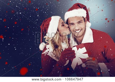 Young festive couple against snow