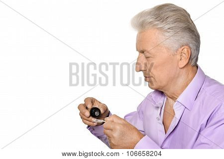 Sick elderly man with syrup on a white background poster