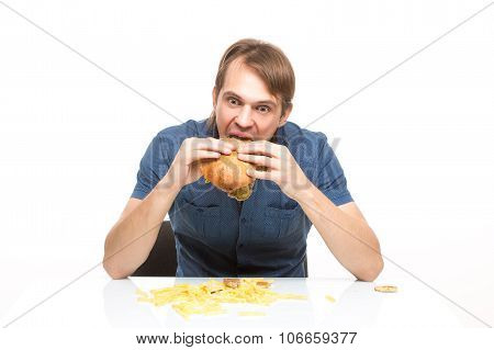 man is not careful eating tasteless burger.
