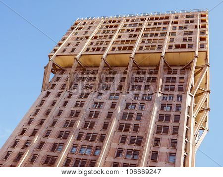 Vintage looking MILAN ITALY - MARCH 28 2015: The Torre Velasca designed in 1955 by BBPR is a masterpiece of Italian new brutalist architecture poster