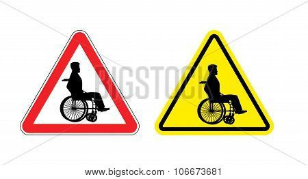 Attention disabled on wheelchair. Warning sign about person in wheelchair. Red and yellow road sign. poster