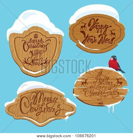 Set Of Wooden Frames With Snow And Handwritten Calligraphic Text Merry Christmas And Happy New Year,