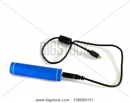 External battery or power bank in a blue metal cylinder with USB cable over white. poster