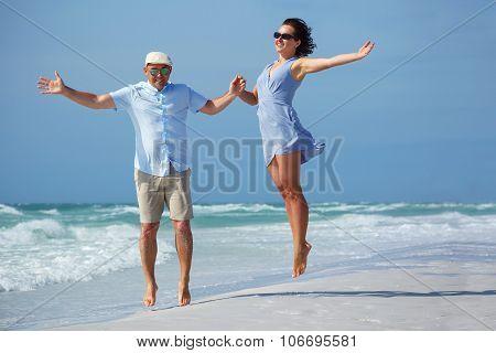 Young couple having fun at tropical beach, Siesta Key, Florida