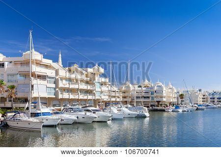 BENELMADENA, SPAIN, JULY 2015: Luxury apartments yachts and motor cruisers moored ouside the luxury apartments in the Port of Benalmadena Cost del Sol Spain