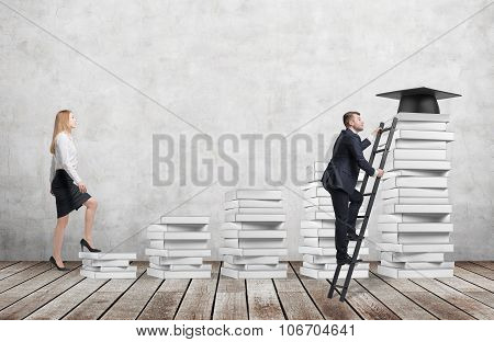 A Woman Is Going Up Using A Stairs Which Are Made Of White Book To Reach Graduation Hat While A Man