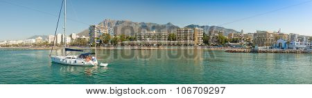 MARBELLA, SPAIN, JULY 2015: A sailing yacht leaves the port at Marina Marbella. A panoramic view of this beautiful marina on the Costa del Sol Spain