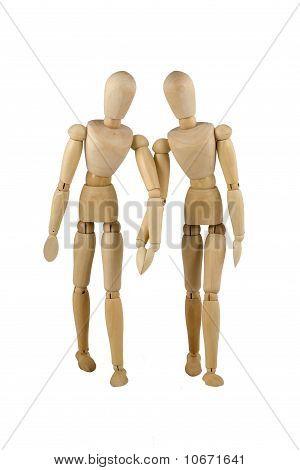 Wooden Dumies Walk Hand To Hand