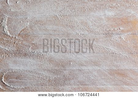 Cutting board background with flour closeup