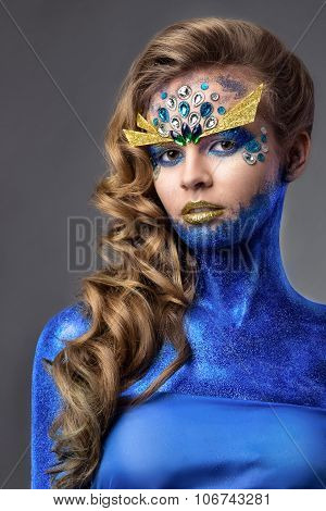 Sensual Attractive Woman In Blue Glitter, Rhinestones On Face, Ocean Creature, Grey Background