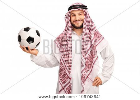 Studio shot of a young male Arab holding a football and looking at the camera isolated on white background